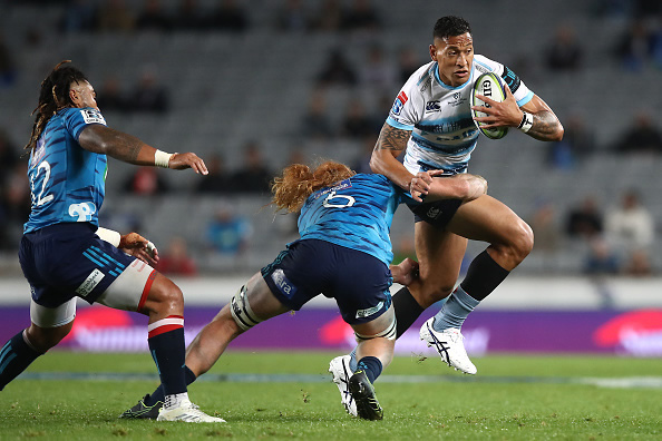 Israel Folau is tackled by Tom Robinson of the Blues