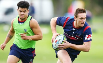 Ross Haylett-Petty of the Rebels runs with the ball during a Melbourne Rebels Super Rugby training session