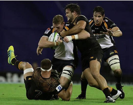 Australia's Brumbies flanker Tom Cusack (C-L) vies for the ball with Argentina's Jaguares prop Santiago Medrano (C) and flanker Marcos Kremer (L) during their Super Rugby match at Jose Amalfitani stadium in Buenos Aires,