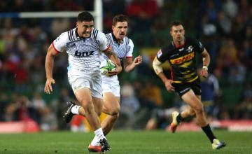 Codie Taylor of the Crusaders runs with the ball during the Super Rugby match between Stormers and Crusaders