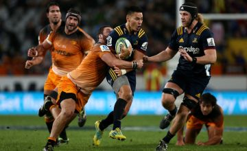 Patelesio Tomkinson of the Highlanders is tackled during the round 13 Super Rugby match between the Highlanders and the Jaguares