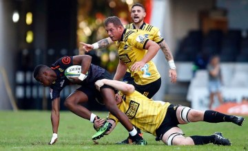 Aphelele Fassi is tackled during the hurricanes Super Rugby victory over the Sharks at Kings Park, Durban