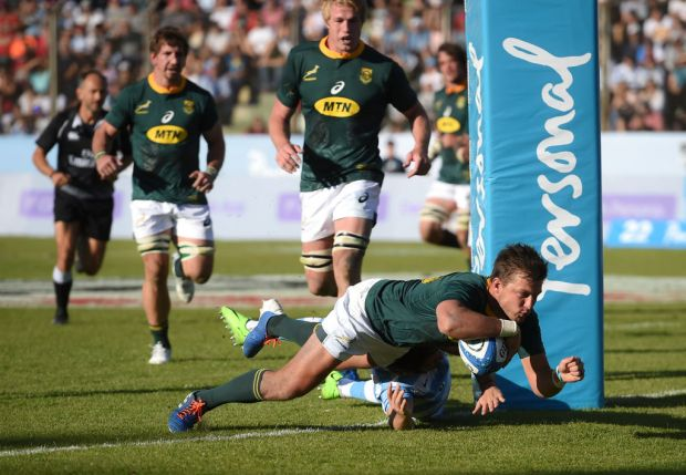 Handre Pollard of South Africa scores a try
