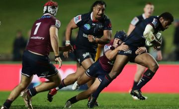 Marika Koroibete is tackled by the Reds in the Rebels' Super Rugby AU victory over Queensland at Brookvale Oval, Sydney