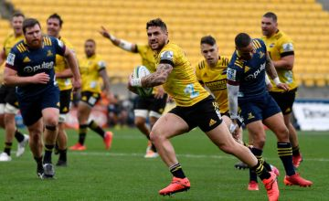 TJ Perenara of the Hurricanes scores a try