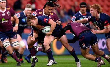 Andrew Kellaway of the Rebels is tackled during the round seven Super Rugby AU match between the Queensland Reds and the Melbourne Rebels