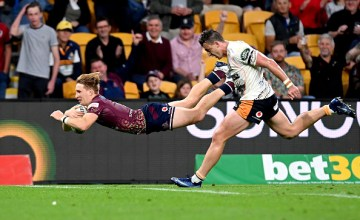 Tate McDermott seals the deal against the Brumbies as the Reds win 26-7 at Suncorp Stadium, Brisabane.