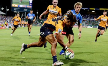 Brumbies flyer Issak Fines-Leleiwasa scores against the Western Force at HBF Park.