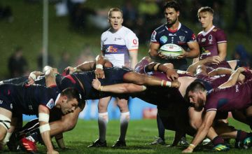 Referee Damon Murphy talks to players during the round 2 Super Rugby AU match between the Rebels and the Reds