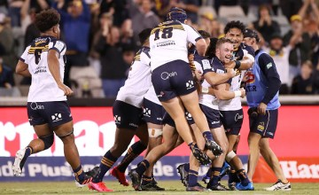 Super Rugby AU R3: Ryan Lonergan celebrates a lot-ditch winning kick as the Brumbies beat the Melbourne Rebels at GIO Stadium, Canberra