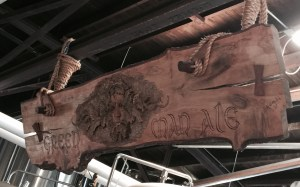 Custom  made Green Man Ale sign hanging in brewery