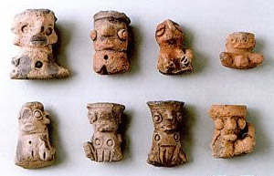 little clay figurines of women with prominent vulvas