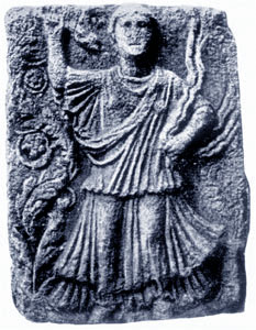 stone relief of dancing woman with snakes