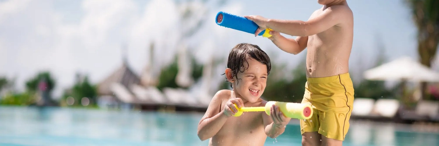 two boys playing at the pool
