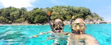 couple with snorkling set in the ocean