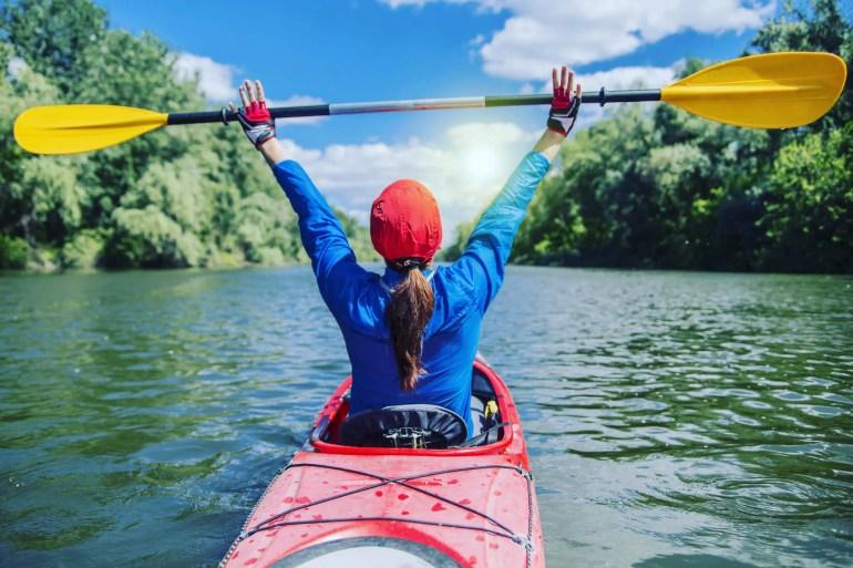 woman happy kayaking