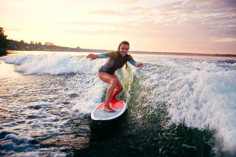 girl having fun surfing