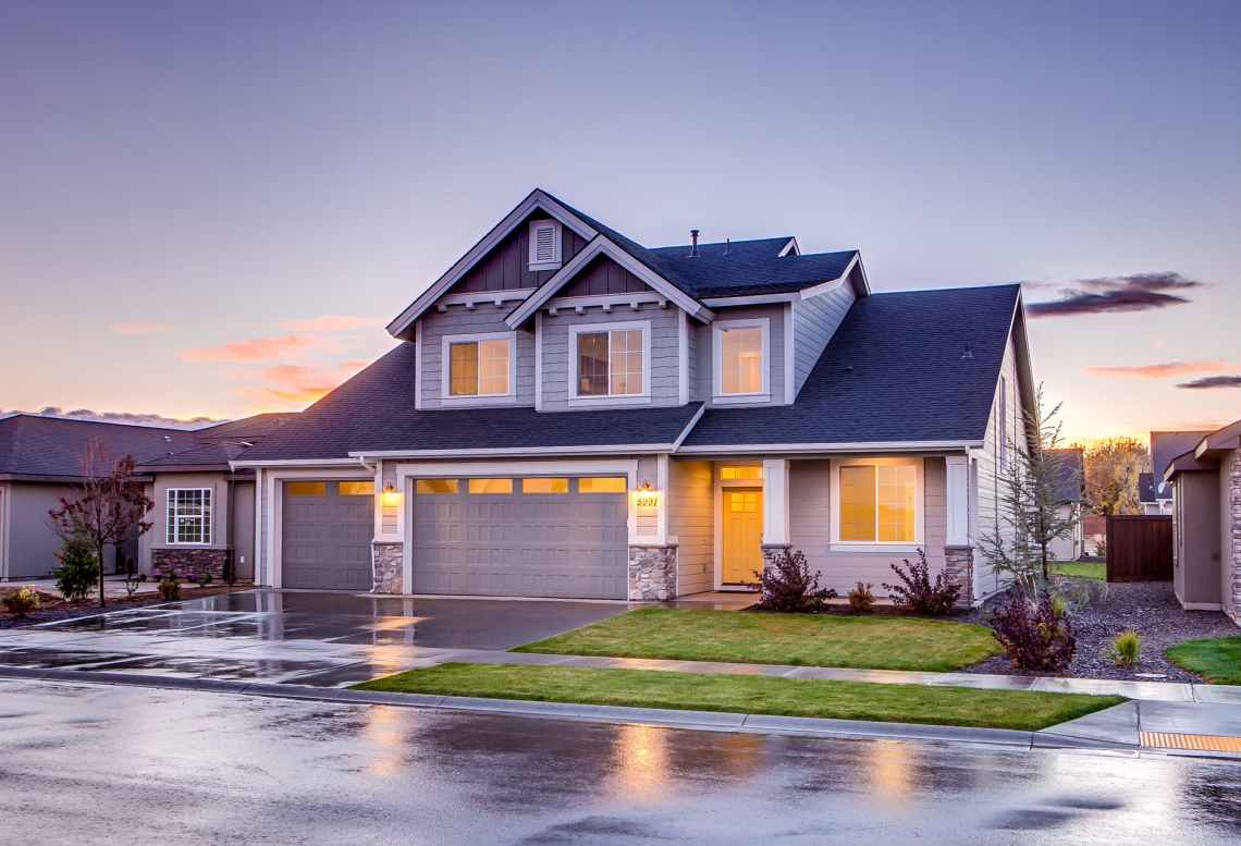 blue and gray concrete house with attic during twilight