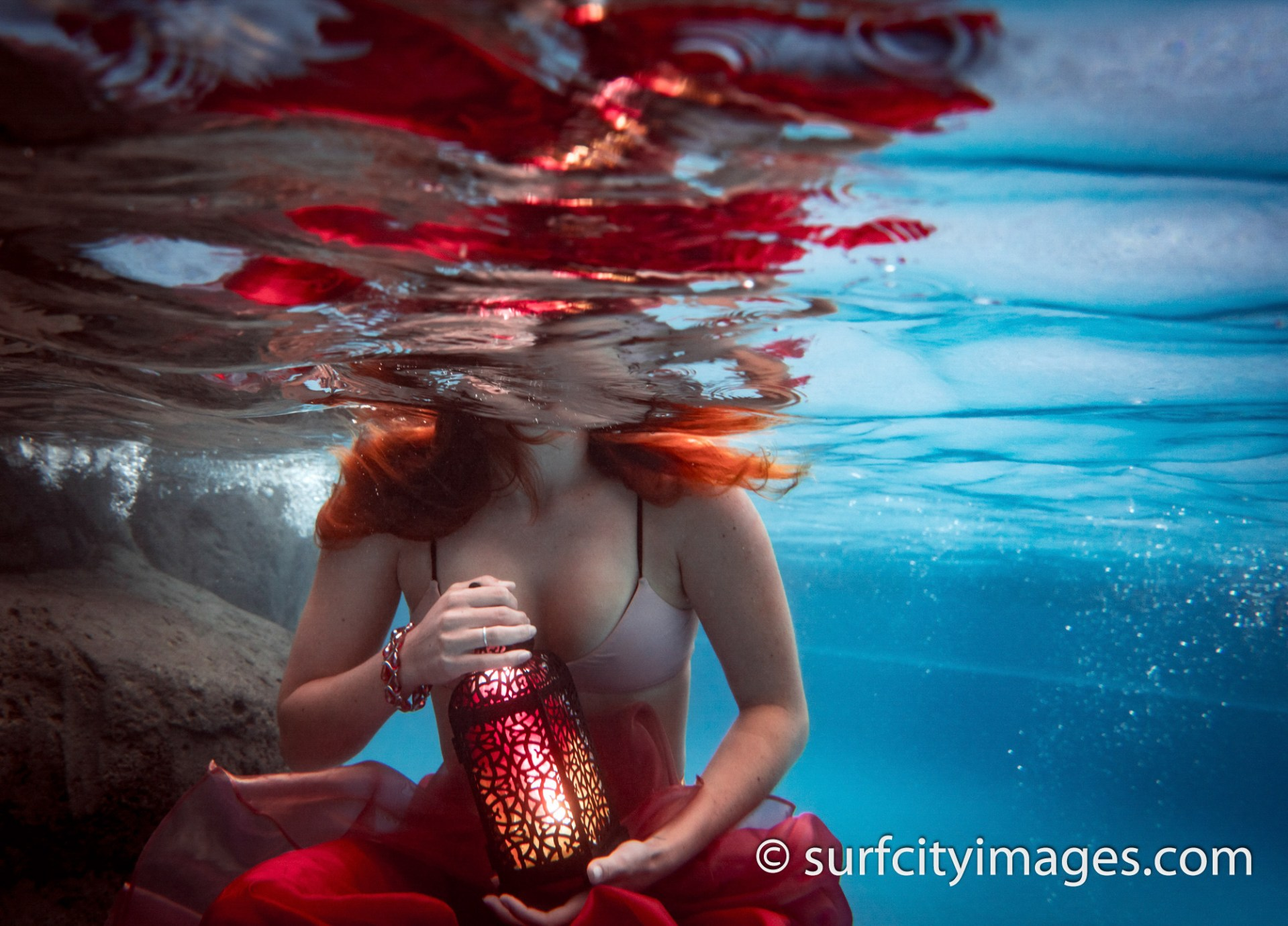 Trash the dress underwater fashion model