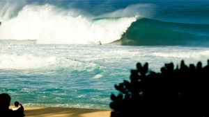 DAY 1: Dave Wassel was among the many locals unfazed by the increasing swell.
