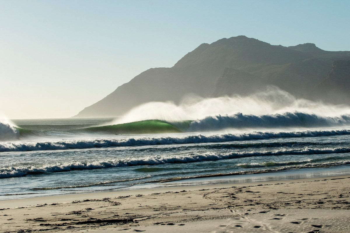 """mThis mesmerizing line-up shot of a spot in Cape Town, South Africa originally appeared as the """"Perfect Day"""" feature in SURFER Volume 60, Issue 3. """"This time of year, this wave usually isn't so perfect,"""" South African photographer Anthony Fox told us of the photo above. """"It's very unusual to have those west swells and a southeast wind. It does get crowded, but when it gets over a certain size the crowd thins out dramatically. I shot those images over a two-day period and the first day was about as big as it can handle, so the crowds were minimal. The tricky part about surfing here is that it's pretty sharky. Of the last three times I've surfed down there, I've been chased out twice by a great white."""""""