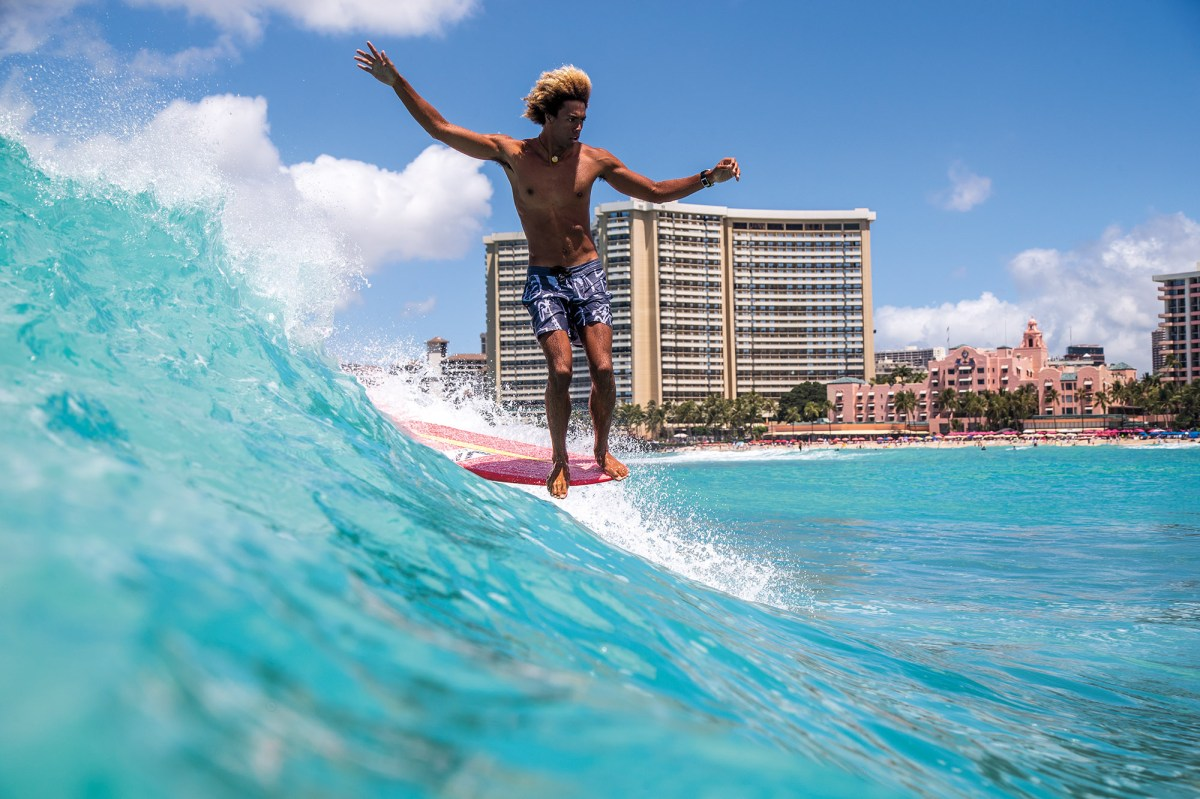 """This wall-hanger of style master Kaniela Stewart was taken at Waikiki by Hawaii-based photographer Tony Heff for the feature titled """"The Kids of Queens"""". Stewart is among a stylish crew of teenagers born on the South Shore of Oahu taking the logging world by storm. Ain't hard to see what's captivating about this shot."""