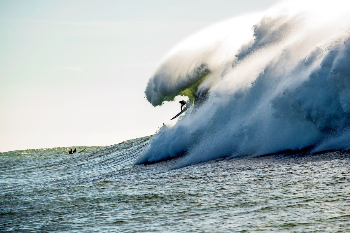 """Grant """"Twiggy"""" Baker, sending it on a mammoth-sized Mavs wave. The big-wave hellman scored one of the opening spreads of SURFER volume 60, issue 1."""