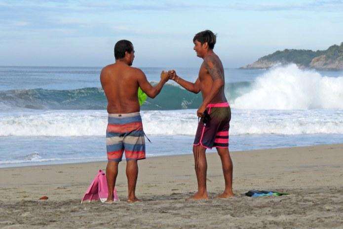 Godofredo Vasquez and Angel Martinez: Puerto Escondido lifeguards getting ready for a bodysurfing matchup | Photo: JP Murphy