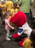 Sammy Surge meets and hugs lots of children