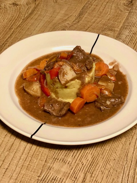 Beef roulade stew with winter vegetables in port
