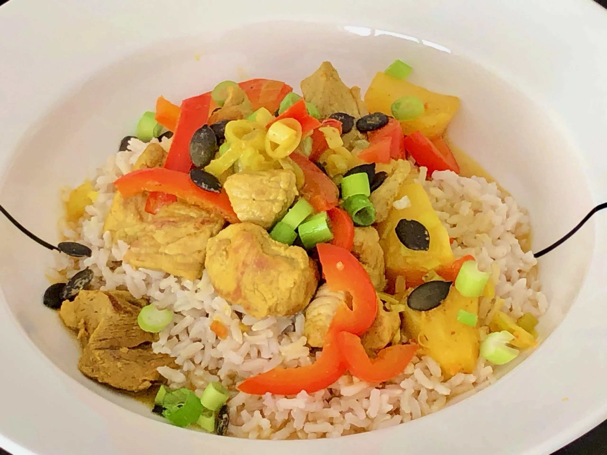 pork stew with a curry of pineapple and bell pepper