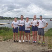 The senior women's quad after their win at Met Regatta with coach Sam Tuck.