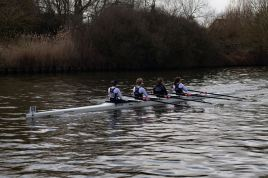 Women's beginner 4x coming up to the finish