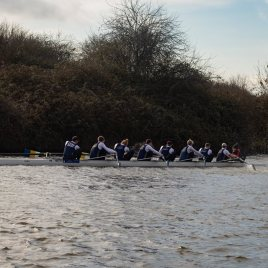 Men's beginner 8+ 'A' charging down the course