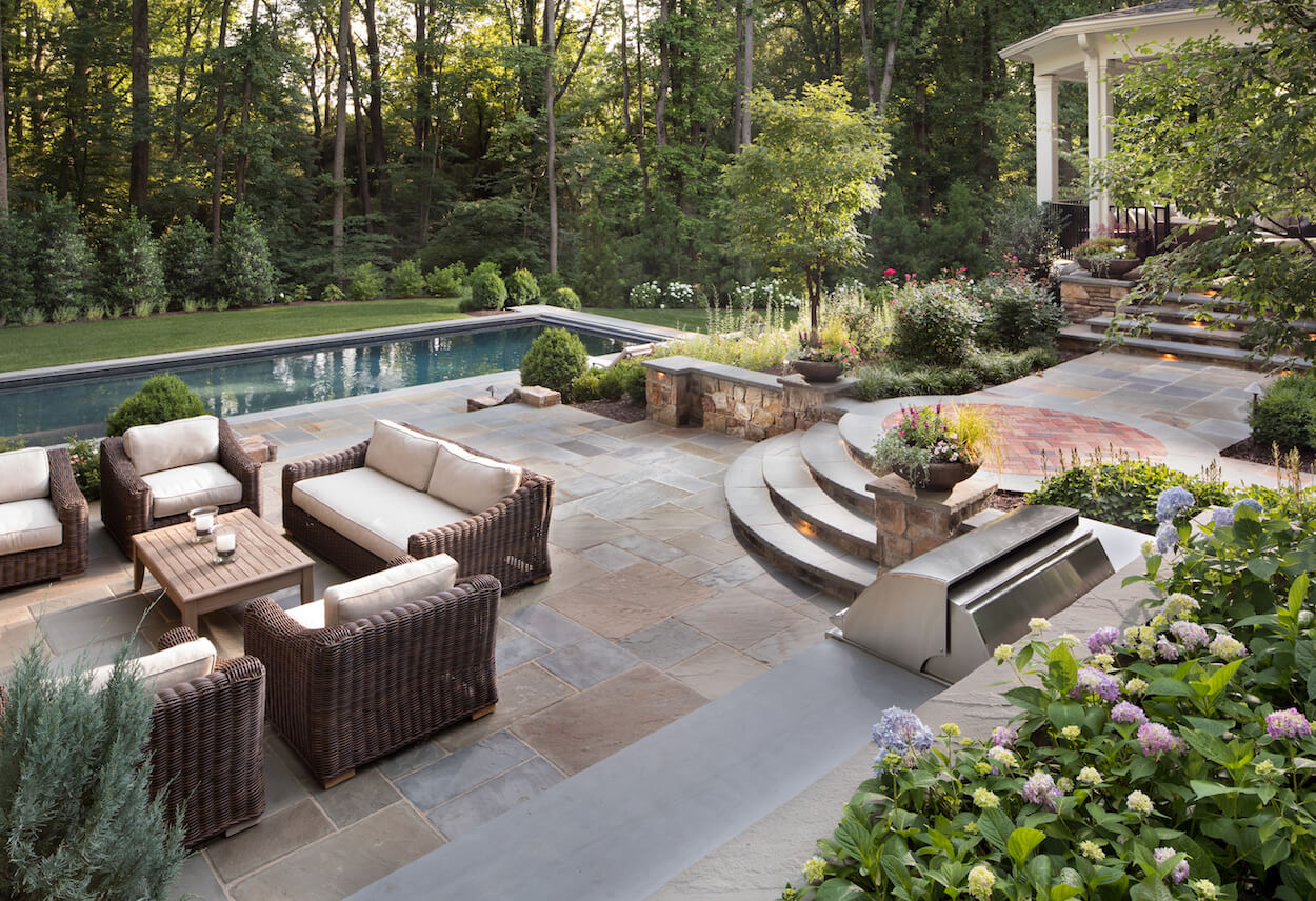 Should You Use Flagstone or Pavers in Your Backyard Patio ... on Rock Patio Designs  id=87423