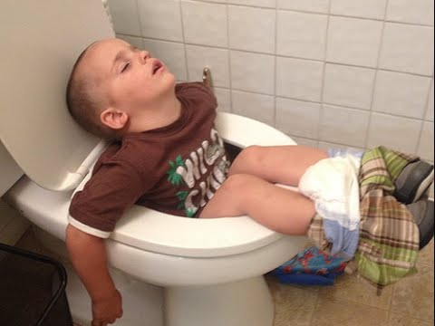 kid Sleeping on toilet
