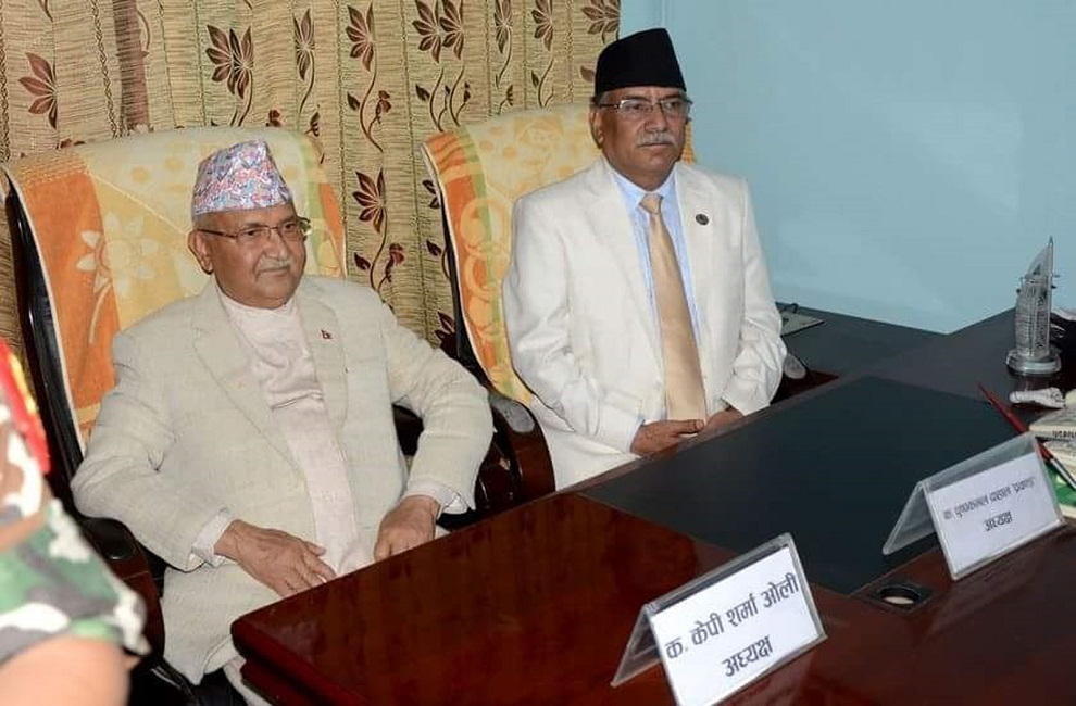 Chair Dahal meets PM Oli, takes stock of PM's health status