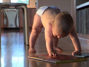 baby playing with a book at Holy in the Daily blog