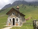 High pastures and a chapel at the Col des Aravis.