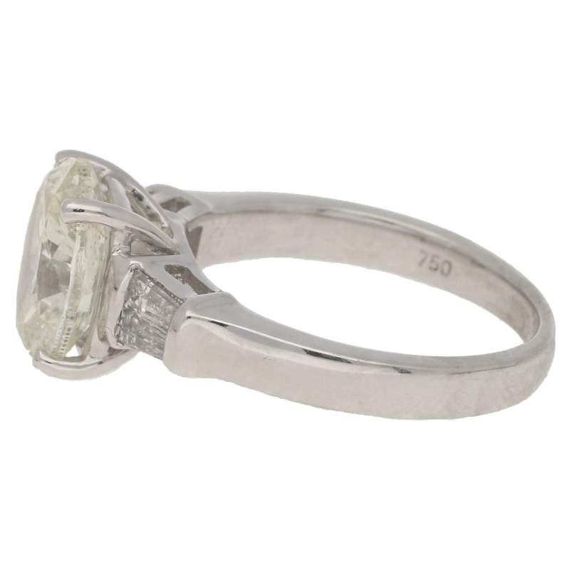 Oval-cut diamond solitaire ring with baguette diamond shoulders