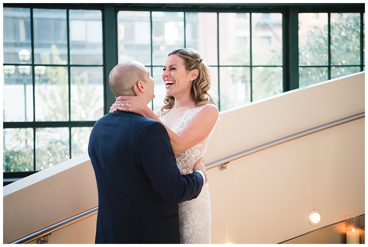 A first-look session of a bride and a groom on a wedding day at Guastavinos in New York City. Dress by Ines Di Santo.