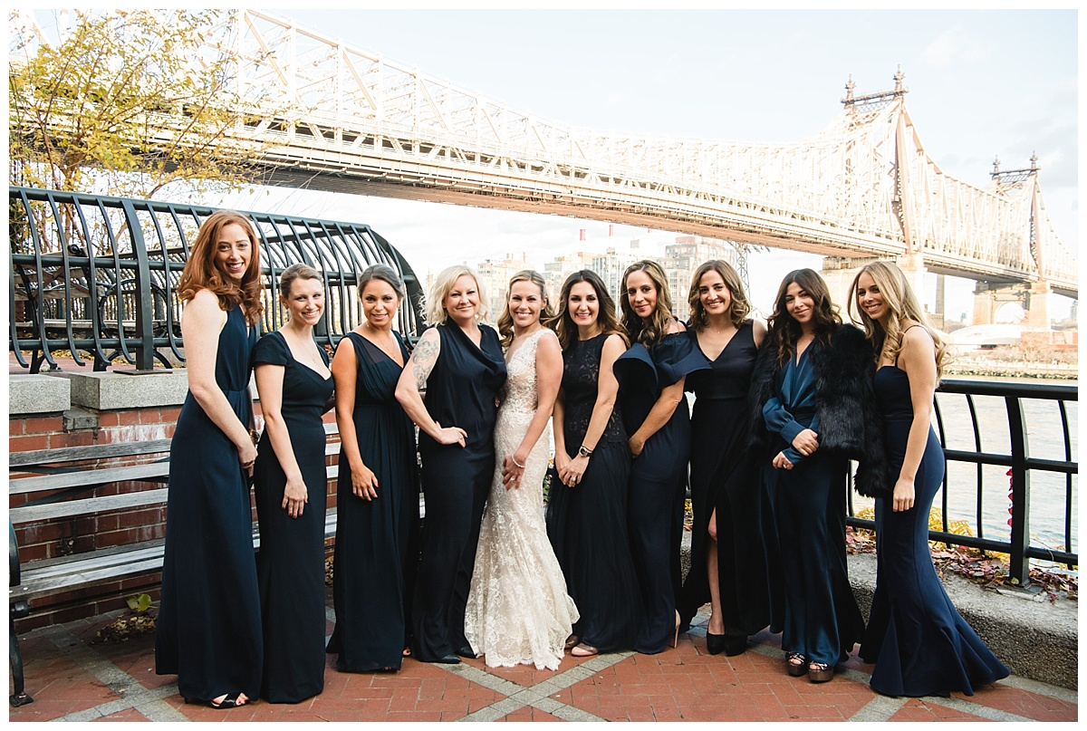 A portrait session of a bride and her bridesmaids on a wedding day at Guastavinos in New York City. Dress by Ines Di Santo.