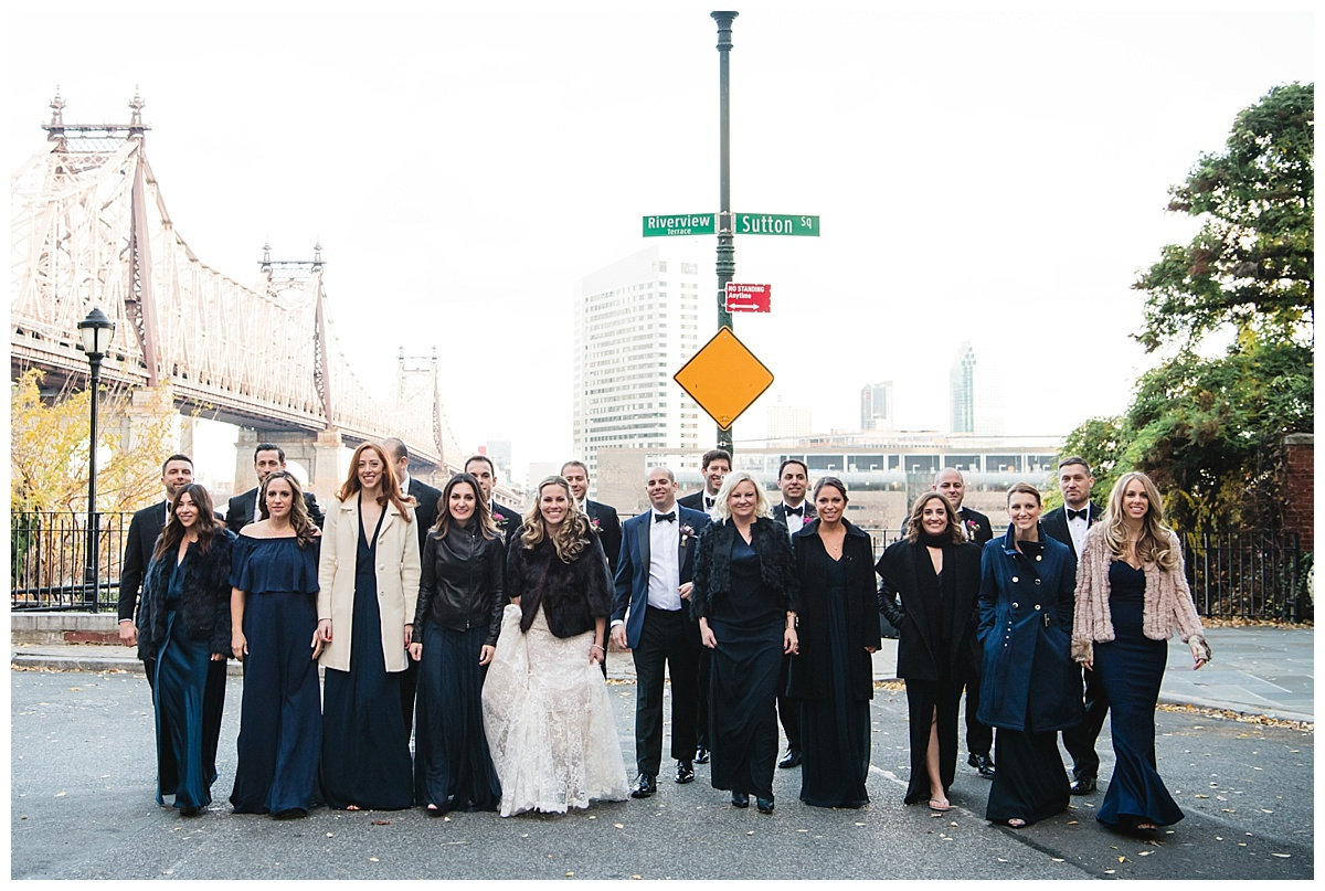 A portrait session of a groom and a bride with their wedding parties on a wedding day at Guastavinos in New York City.
