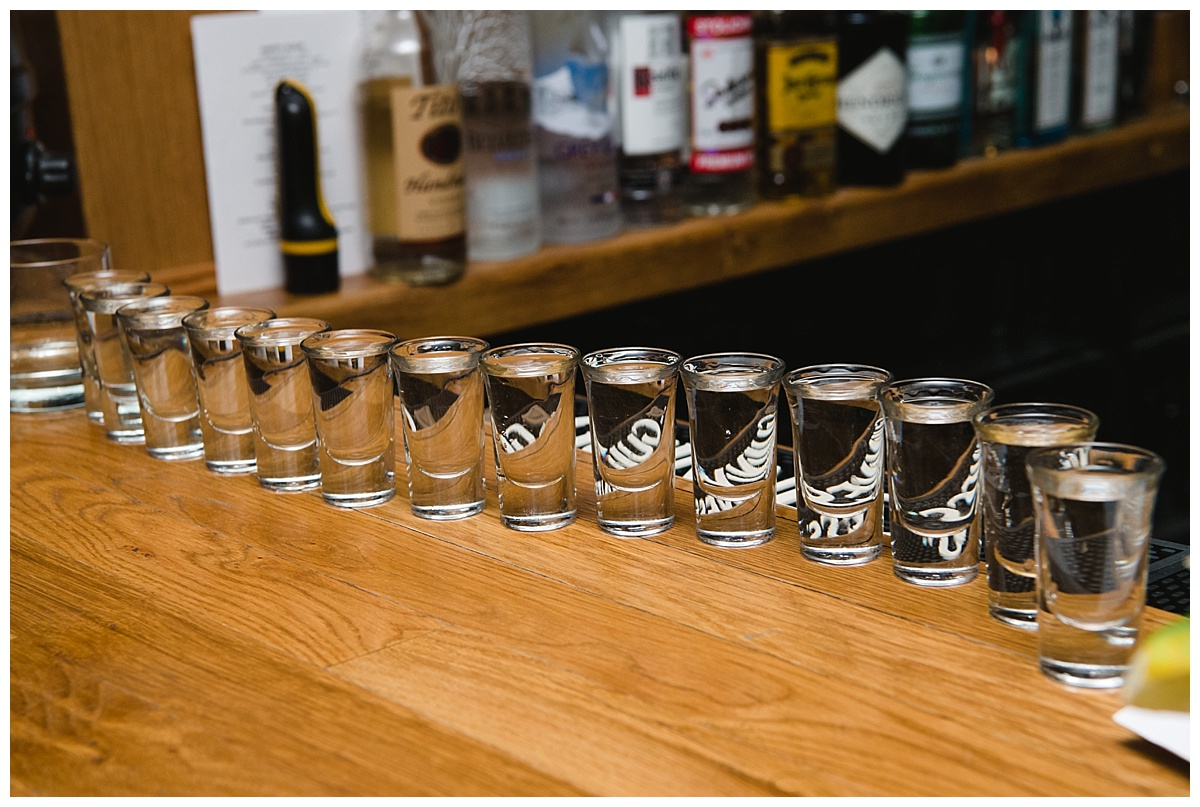 A shot glasses at a bar on a wedding day at Guastavinos in New York City.