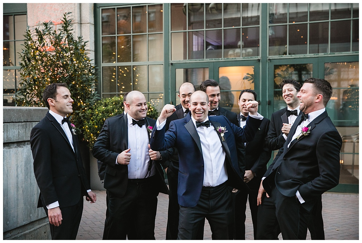 A groomsman hanging out with his groomsmen on a wedding day at Guastavinos in New York City.
