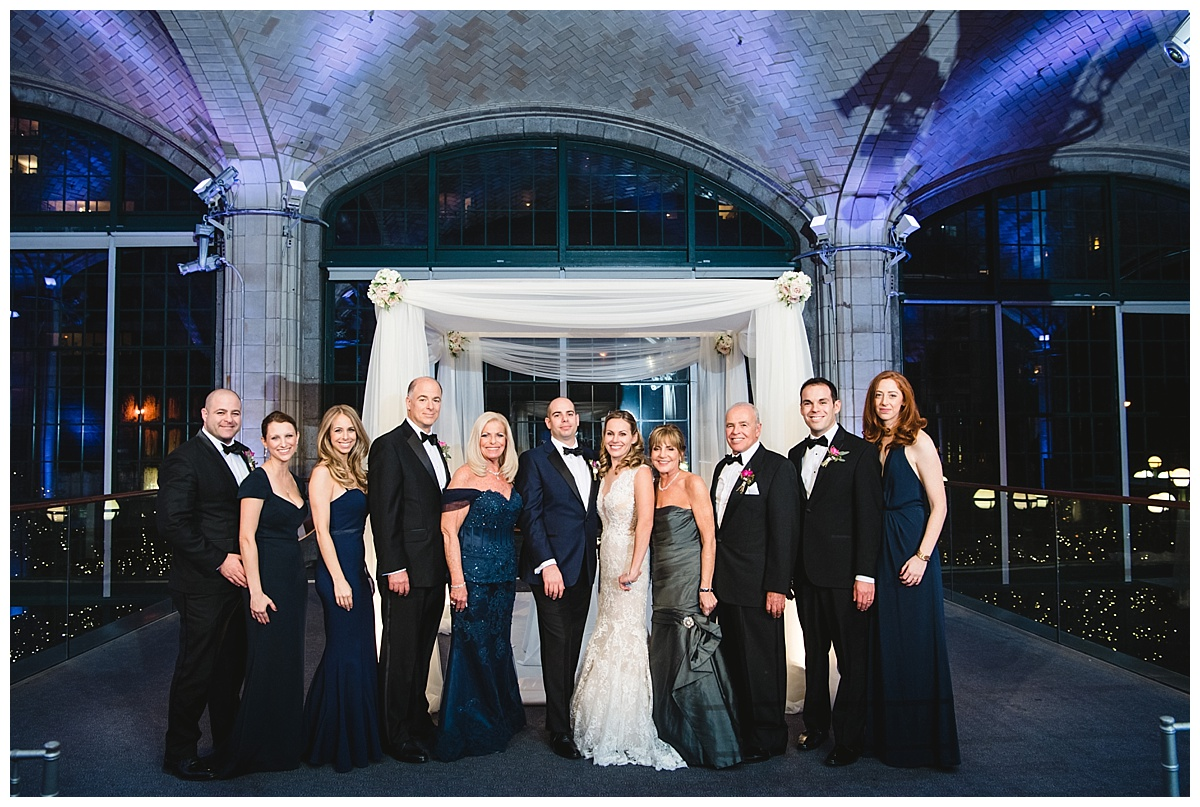 A portrait session of a groom and a bride with their immediate family at Guastavinos in New York City. Dress by Ines Di Santo.