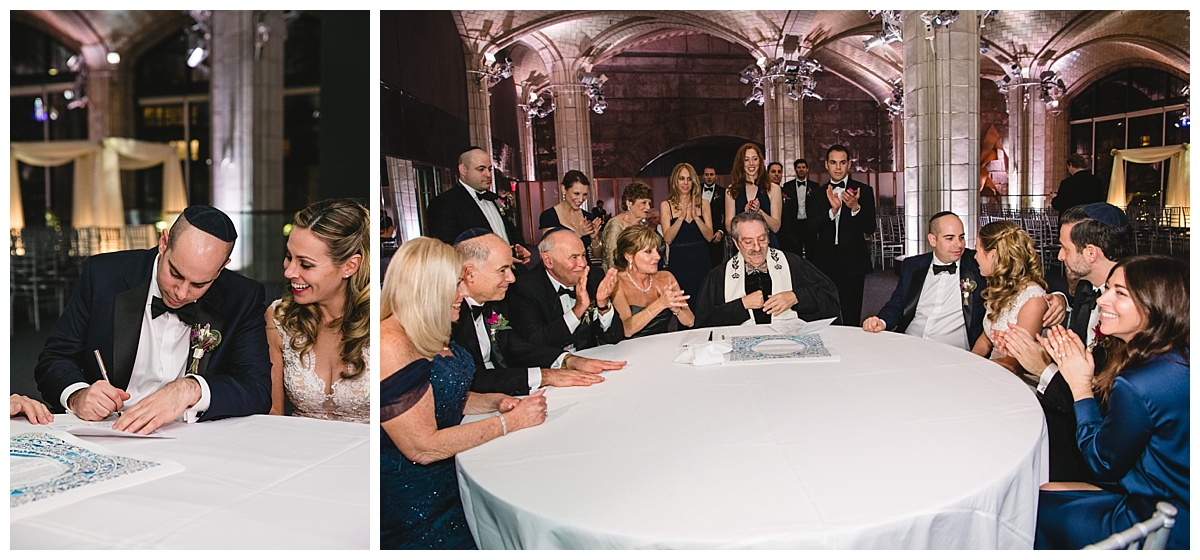 A bride and a groom signing a ketubah surrounded by their immediate family and friends at Guastavinos in New York City.