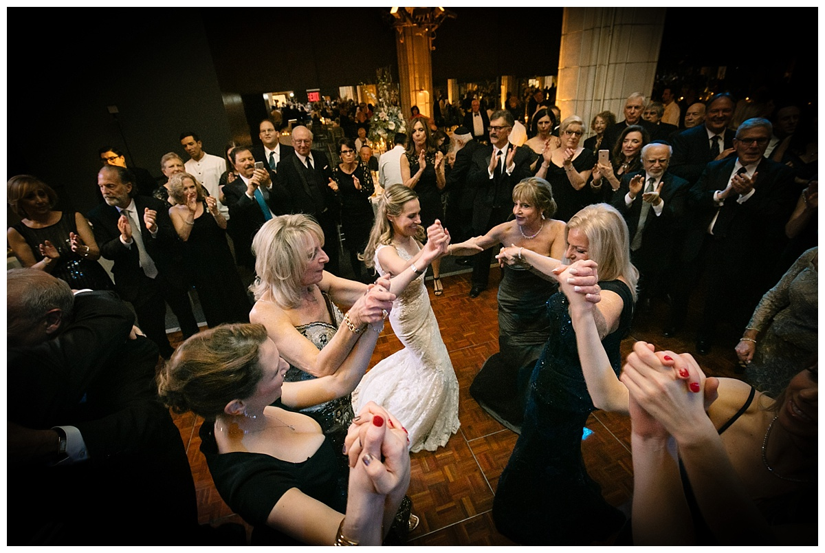 A bride and wedding guests dancing during a wedding reception at Guastavinos in New York City. Dress by Ines Di Santo.