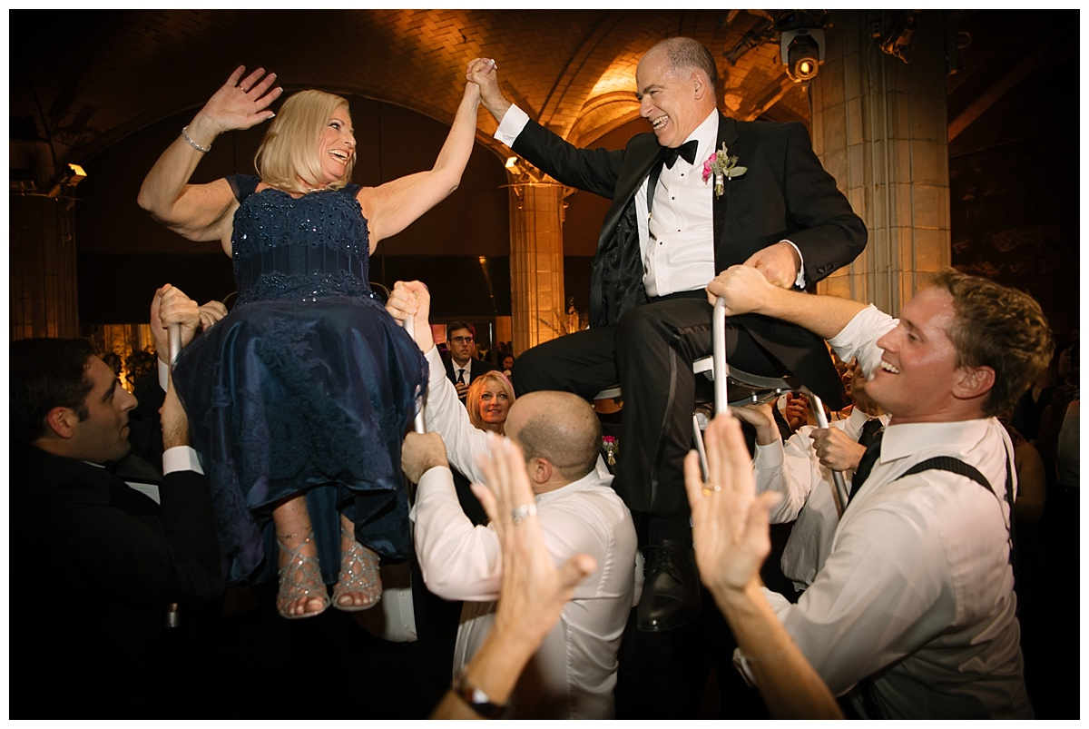 A chair dance or a horah during a wedding reception at Guastavinos in New York City.