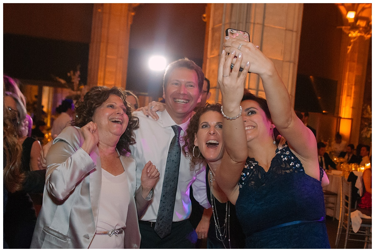 Wedding guests taking a selfie during a wedding reception at Guastavinos in New York City.